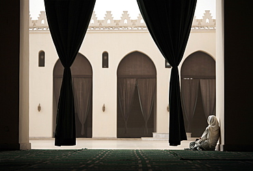 Woman sitting in the Mosque of Al-Hakim, Cairo, Egypt, North Africa, Africa