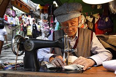 A tailor at work in Hong Kong, China, Asia