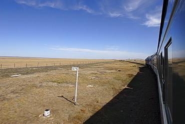 Trans-Mongolian train travelling through the Gobi desert en route to Ulaan Baatar, Mongolia, Central Asia, Asia