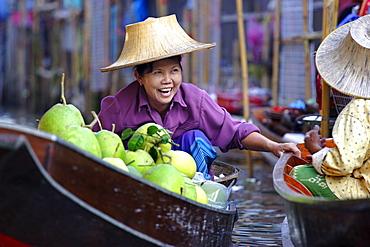 Local women share a joke at Damnoen Saduak Floating Market, Thailand, Southeast Asia, Asia