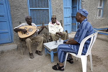 Locals relax with some traditional music, on the streets of Berbera, Somaliland, Somalia, Africa