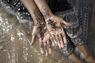 Henna adorn the hands of a Muslim woman on the beach at Berbera, Somaliland, Somalia, Africa