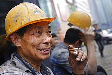 Construction workers take a cigarette break, Chongqing, China, Asia