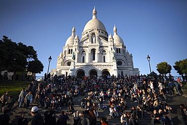 Tourists gather at the Sacre Coeur, Montmartre, Paris, France, Europe