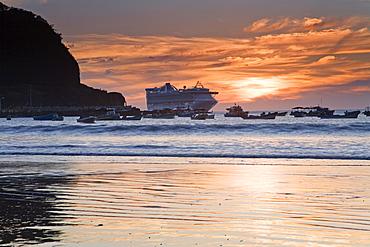 Cruise ship at sunset in San Juan Del Sur, Department of Rivas, Nicaragua, Central America