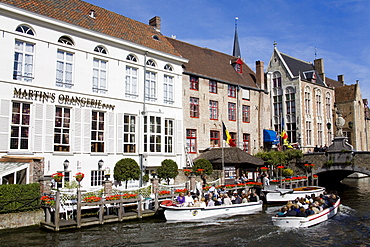 Tour boat on the canal in Bruges, West Flanders, Belgium, Europe