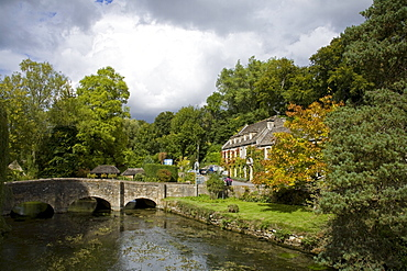 Swan Hotel and River Coln, Bibury Village, Gloucestershire, Cotswolds, England, United Kingdom, Europe