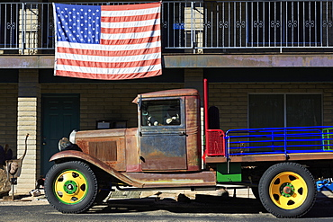 Old truck and American flag, Cave Creek, Arizona, United States of America, North America