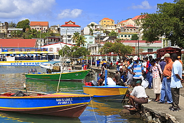 Selling fish in The Carenage, St. Georges, Grenada, Windward Islands, West Indies, Caribbean, Central America
