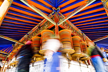 Spinning prayer wheels, Xiahe monastery, Xiahe, Gansu, China, Asia