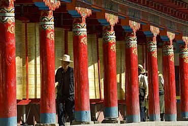 Old men turning prayer wheels, Tagong temple, Tagong, Sichuan, China, Asia