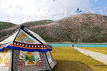 Tent and thousands of prayer flags, Tagong Grasslands, Sichuan, China, Asia