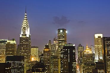 City skyline including the Chrysler Building at dusk, Manhattan, New York, United States of America, North America