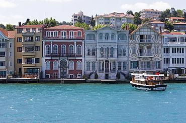 The restored waterfront buildings of Yenikoy on the Bosphorus, Istanbul, Turkey, Europe
