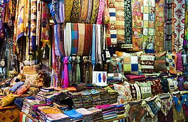 Fabrics, rugs, scarves, cushions for sale, Grand Bazaar (Great Bazaar), Istanbul, Turkey, Europe
