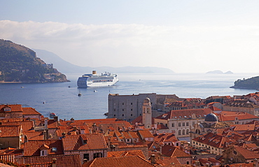 Rooftops, cruise ship and the island of Lokrum from Dubrovnik Old Town walls, Dubrovnik, Croatia, Europe
