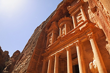 The facade of the Treasury (Al Khazneh) carved into the red rock at Petra, UNESCO World Heritage Site, Jordan, Middle East