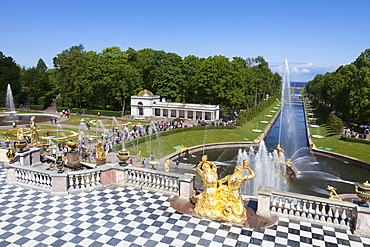 Golden statues and fountains of the Grand Cascade at Peterhof Palace with the Marine Canal, St. Petersburg, Russia, Europe