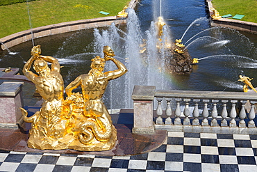 Golden statues and fountains of the Grand Cascade at the Peterhof Palace, St. Petersburg, Russia, Europe