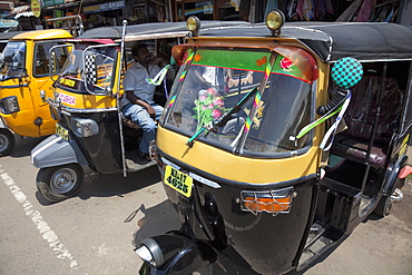 Auto rickshaws for hire in the street in Munnar, Kerala, India, Asia