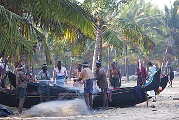 Fishermen sorting their nets at Marari Beach, Kerala, India, Asia