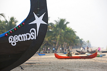 Traditional fishing boats at Marari Beach, Kerala, India, Asia