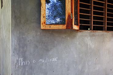 Chalk sign on a house in Mararikulam, Kerala, India, Asia