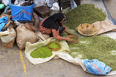 Lady grinding spices in Rahba Kedima (Old Square), Marrakech, Morocco, North Africa, Africa