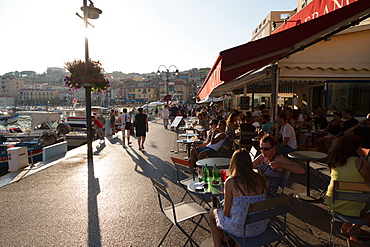 Cafe life on the waterfront at the harbour of the historic town of Cassis, Cote d'Azur, Provence, France, Europe