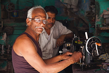 Man repairing an old sewing machine in the city of Jodhpur, Rajasthan, India, Asia