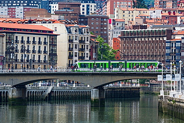 Tram crossing the river Nervion in Bilbao, Biscay (Vizcaya), Basque Country (Euskadi), Spain, Europe
