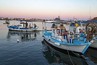 Traditional fishing boats moored in Paphos harbour in southern Cyprus at dusk, Cyprus, Mediterranean, Europe