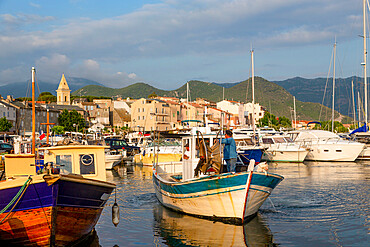 Traditional fishing boat moored in the small harbour of Saint Florent in northern Corsica