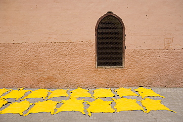 Dyed leather hides drying in street in the souk, Medina, Marrakech, Morocco, North Africa, Africa