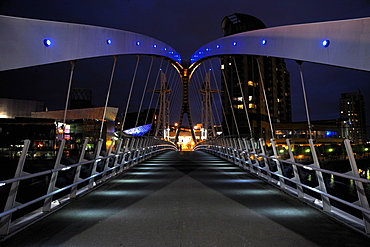 Night view of The Lowry Bridge over the Manchester Ship Canal, Salford Quays, Greater Manchester, England, United Kingdom, Europe