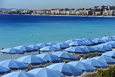 Beach umbrellas viewed from the Promenade des Anglais, Nice, Alpes Maritimes, Provence, Cote d'Azur, French Riviera, France, Mediterranean, Europe