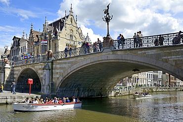 Pleasure boat on the river passing under St. Michaels bridge, Ghent, Flanders, Belgium, Europe