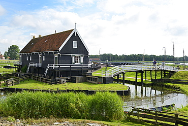 Canal and traditional building, Zuiderzee Open Air Museum, Lake Ijssel, Enkhuizen, North Holland, Netherlands, Europe