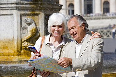 Senior tourists sightseeing in St. Peters Square, Rome, Italy, Europe