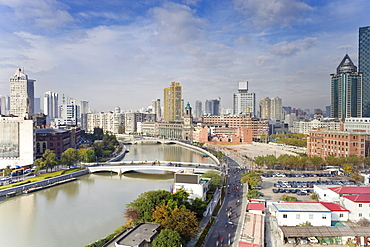 Elevated view along Suzhou Creek, new bridges and city skyline, Shanghai, China, Asia
