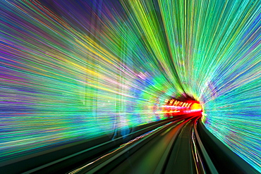 Blurred motion light trails in a train tunnel under the Huangpu River linking the Bund to Pudong, Shanghai, China, Asia