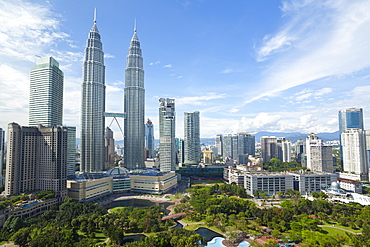 City centre including the KLCC park convention and shopping centre and the iconic 88 storey steel clad Petronas Towers, Kuala Lumpur, Malaysia, Southeast Asia, Asia