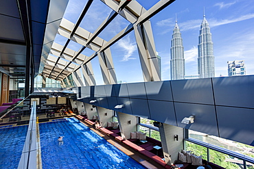 View from a rooftop pool and skybar of the iconic 88 Petronas Towers, Kuala Lumpur, Malaysia, Southeast Asia, Asia