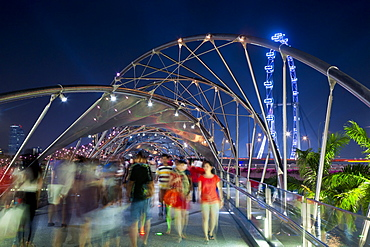 The Helix bridge at Marina Bay and Singapore Flyer, Singapore, Southeast Asia, Asia