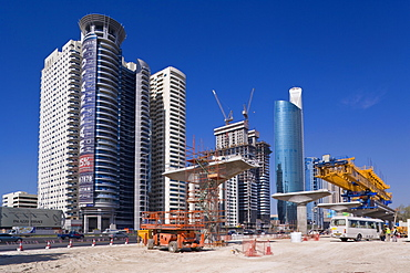 Skyscrapers and new constuction of the Dubai monorail line along Sheikh Zayed Road, Dubai, United Arab Emirates, Middle East