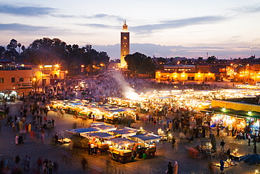 Elevated view of the Koutoubia Mosque at dusk from Djemaa el-Fna, Marrakech, Morocco, North Africa, Africa