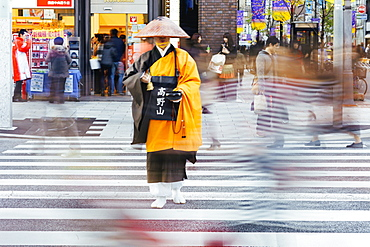 Shinto monk in traditional dress collecting alms (donations), Ginza, Tokyo, Honshu, Japan, Asia