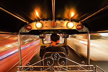 Tuk-tuk (auto rickshaw) in motion at night, Bangkok, Thailand, Southeast Asia, Asia