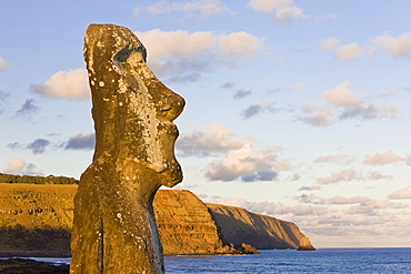 Lone monolithic giant stone Moai statue looking out to sea at Tongariki, Rapa Nui (Easter Island), UNESCO World Heritage Site, Chile, South America