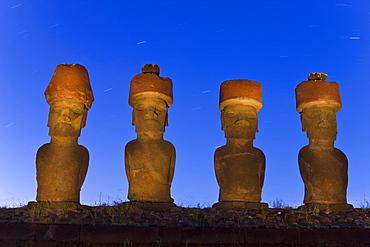 Anakena beach, monolithic giant stone Moai statues of Ahu Nau Nau, four of which have topknots, illuminated at dusk, Rapa Nui (Easter Island), UNESCO World Heritage Site, Chile, South America
